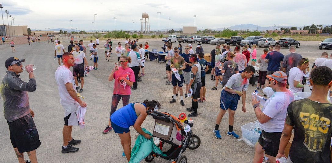 Airmen and their families gather at the finish line after the 5k Color Run/Walk, April 7, 2017, at Nellis Air Force Base, Nev. The 5k Color Run/Walk was open for all Department of Defense ID holders to participate in. (U.S. Air Force photo by Airman 1st Class Andrew D. Sarver/ Released)