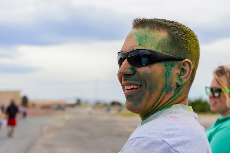 Chief Master Sgt. William Arcuri, 99th Air Base Wing acting command chief, relaxes after finishing the 5k Color Run/Walk, April 7, 2017, at Nellis Air Force Base, Nev. Several base agencies set up stands at the finish line to provide snacks and further information on the services they provide Airmen and their families. (U.S. Air Force photo by Airman 1st Class Andrew D. Sarver/ Released)