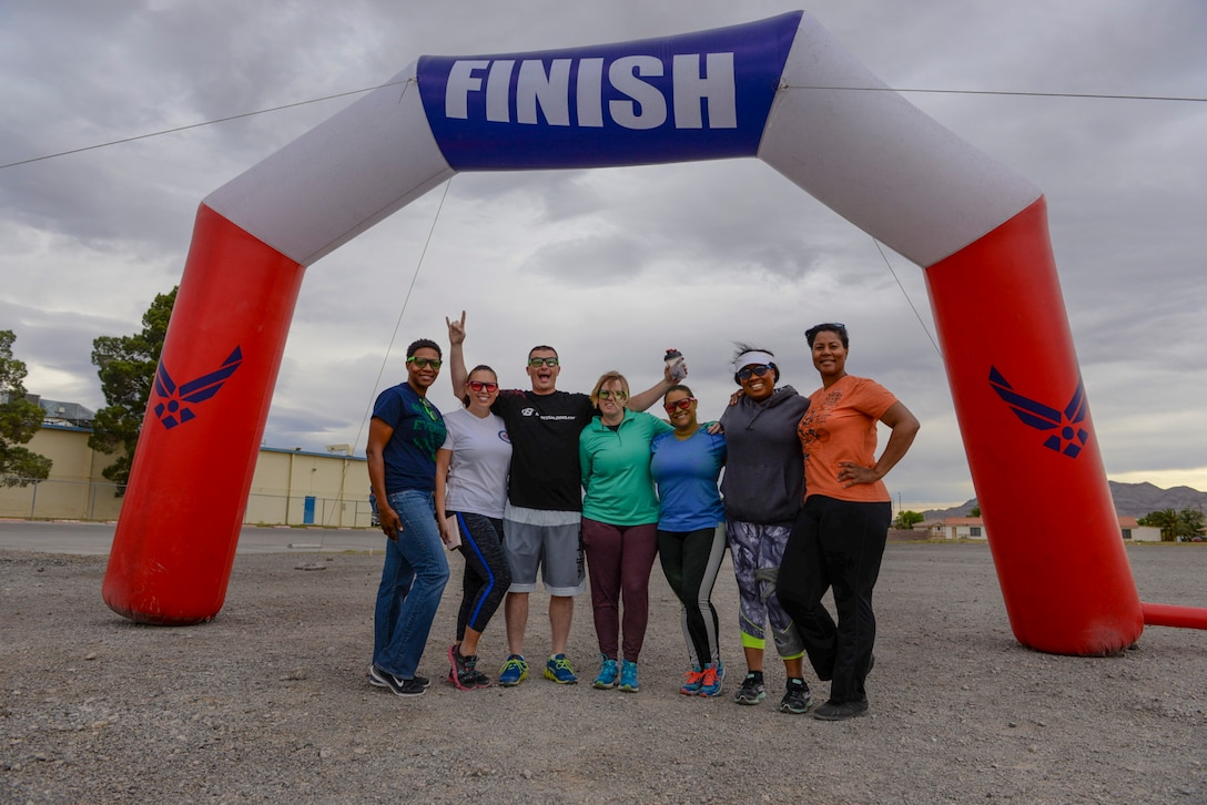 Master Resilience Trainers from Nellis and Creech Air Force Bases pose for a group photo after the 5k Color Run/Walk, April 7, 2017, at Nellis Air Force Base, Nev. MRTs are Department of Defense certified trainers for resiliency. They instruct resiliency techniques to military service members and their families. (U.S. Air Force photo by Airman 1st Class Andrew D. Sarver/ Released)