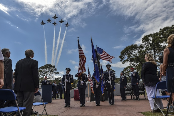 The U.S. Air Force Thunderbirds perform a flyover as the Pensacola Christian College choir sings the National Anthem during a dual Air Force Cross ceremony, April 20, 2017, at Hurlburt Field, Fla. For the first time in Air Force history, two Airmen were simultaneously awarded the service's highest medal for valorous action in combat. Miller, from the Air National Guard's 123rd Special Tactics Squadron, and Chris Baradat, a combat controller since separated, both received Silver Star medals for their actions in combat, which were upgraded after a service-wide review. (U.S. Air Force photo by Senior Airman Ryan Conroy)