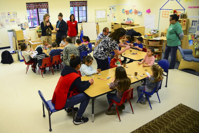 Representatives from the 92nd Civil Engineer Squadron teach kids how to plant their own seeds in a mini planter as part of the Earth Day celebration at the Child Development Center Apr. 20, 2017, at Fairchild Air Force Base, Washington. The Air Force will also be celebrating its 70th anniversary this year, with innovation, teamwork and heritage being the key themes. All of which are relevant to how the base protects and sustains the environment while completing the mission. (U.S. Air Force photo/Senior Airman Janelle Patiño)