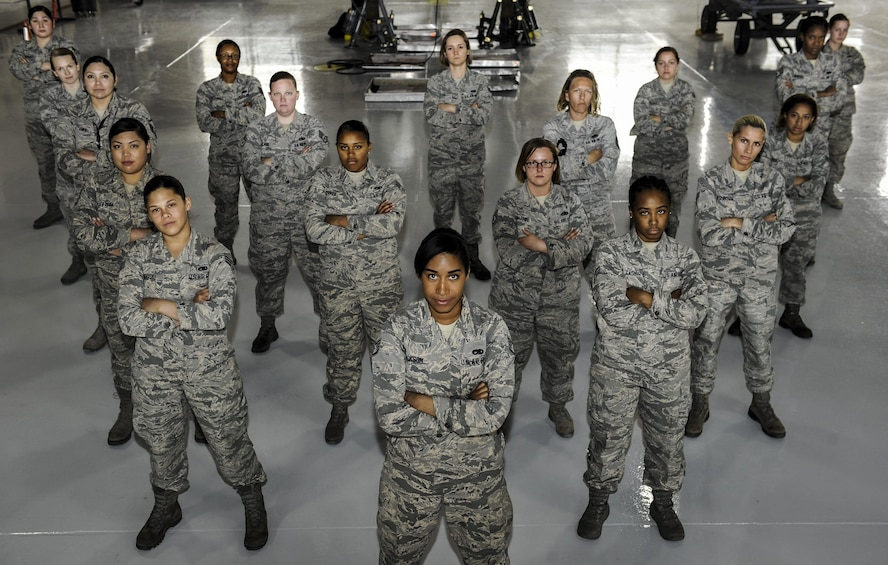 Airmen from the 57th Maintenance Group pose for a photo on March 22, 2017, at Nellis Air Force Base, Nev. The mission of the Airmen assigned to the 57th Maintenance Group is to bear the responsibility of ensuring that flying programs on Nellis AFB can accomplish their own missions at all times. (U.S. Air Force photo by Senior Airman Kevin Tanenbaum)