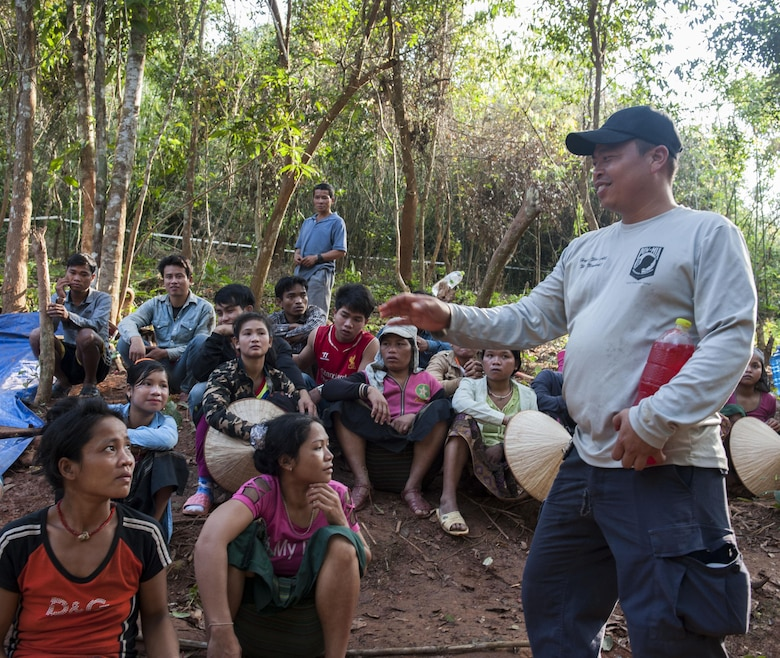 U.S. Army Staff Sgt. Franois Sangiamvongse, Defense Prisoner of War/Missing in Action analyst and Lao linguist, speaks with citizens of the Lao People's Democratic Republic March 24, 2017, in the Khommouon province in the country of Laos. Partnerships with different countries guarantee mission continuity with DPAA of returning America's missing heroes home. The mission of DPAA is to provide the fullest possible accounting for our missing personnel to their families and the nation. (U.S. Air Force photo by Senior Airman Lynette M. Rolen/Released)