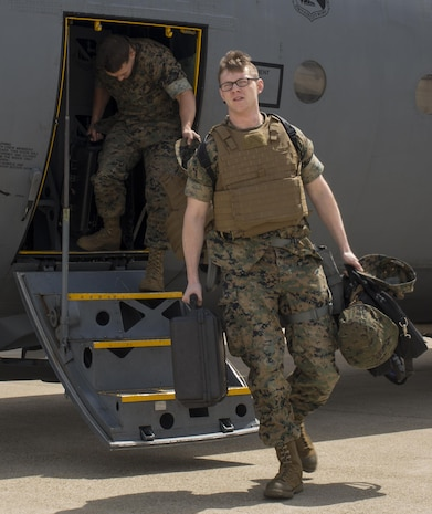 U.S. Marine Corps Lance Cpl. Jeffrey Tschirhart, an aviation operations specialist with Marine Attack Squadron (VMA) 311, and Sgt. Albert Ludwig, a nondestructive inspection technician with Marine Aviation Marine Aviation Logistics Squadron (MALS) 12, arrive at Kunsan Air Base, Republic of Korea, April 12, 2017. MALS 12 and VMA 311 are participating in Exercise MAX THUNDER 17, an operational readiness exercise built to promote interoperability between U.S. and ROK forces. This annual exercise helps to promote stability in the Asia-Pacific region. (U.S. Marine Corps photo by Lance Cpl. Carlos Jimenez)