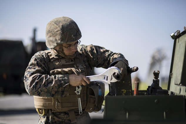 U.S. Marine Corps Cpl. Jeffrey Aceti, a combat engineer with Marine Wing Support Squadron (MWSS) 171, maintains equipment used during airfield damage and repair training at Marine Corps Air Station Iwakuni, Japan, April 19, 2017. The ADR training required Marines to utilize their skill set to tactically and proficiently fix any anomalies to a simulated damaged airfield. The training focused on becoming more efficient in situations that may require Marines to act in real-world scenarios to maintain the tempo of aircraft operations. (U.S. Marine Corps photo by Lance Cpl. Joseph Abrego)
