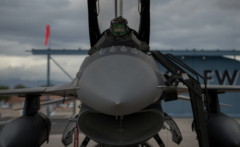 Iraqi Air Force Capt. Hama, student pilot, conducts preflight inspections while inside a new to service Iraqi F-16 Fighting Falcon located at the nearby Tucson International Airport, Dec. 17, 2014. Hama was part of the first class of Iraqi students training with the 162nd Wing to further enhance interoperability between the two partner nations. (U.S. Air Force photo/Senior Airman Jordan Castelan)