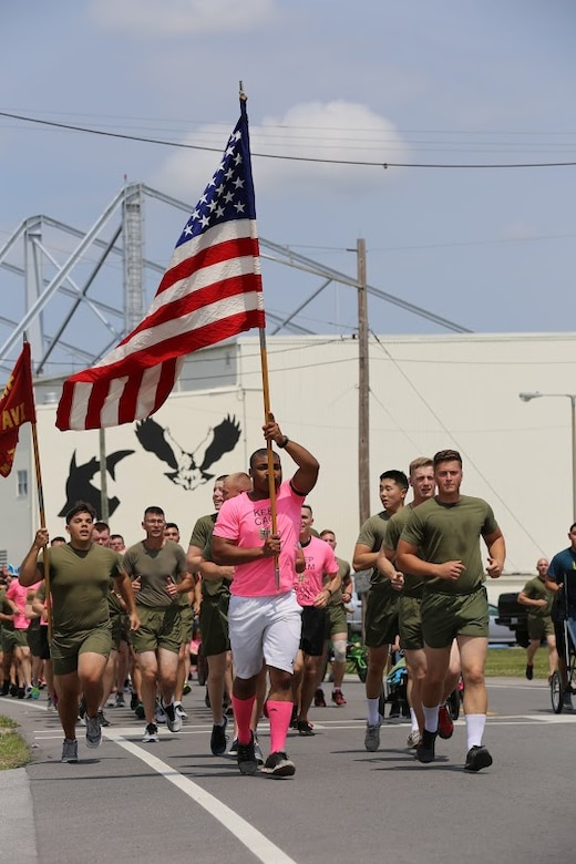 Marines call cadences during a formation run at Marine Corps Air Station New River, N.C., April 13, 2017. More than 220 Marines assigned to Marine Aviation Logistics Squadron 26, Marine Aircraft Group 26, 2nd Marine Aircraft Wing  gathered to run with disabled children as part of an Ainsley's Angels East Carolina chapter event at the air station. The unit participated in the event to show their support for the local community and share their Espirit De Corps. ( U.S. Marine Corps photo by Sgt. N.W. Huertas/ Released)