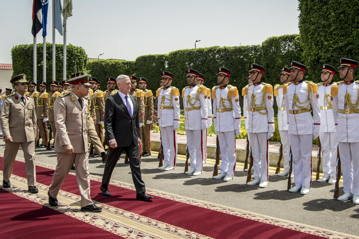 Defense Secretary James N. Mattis walks with the Egyptian defense minister on a red carpet.
