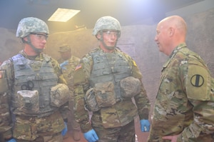 Maj. Gen. Glen Moore (right), deputy commanding general, Army National Guard, U.S. Army Training and Doctrine Command, speaks with Army students in the combat medic training program at the Medical Education and Training Campus at Joint Base San Antonio-Fort Sam Houston April 14. Moore observed the students as they trained in the Combat Trauma Patient Simulator, a simulation lab that provides a realistic type of training experience for students learning how to treat trauma wounds on casualties in a combat environment. About half of the students in the combat medic training program are in the National Guard or Army Reserve.
