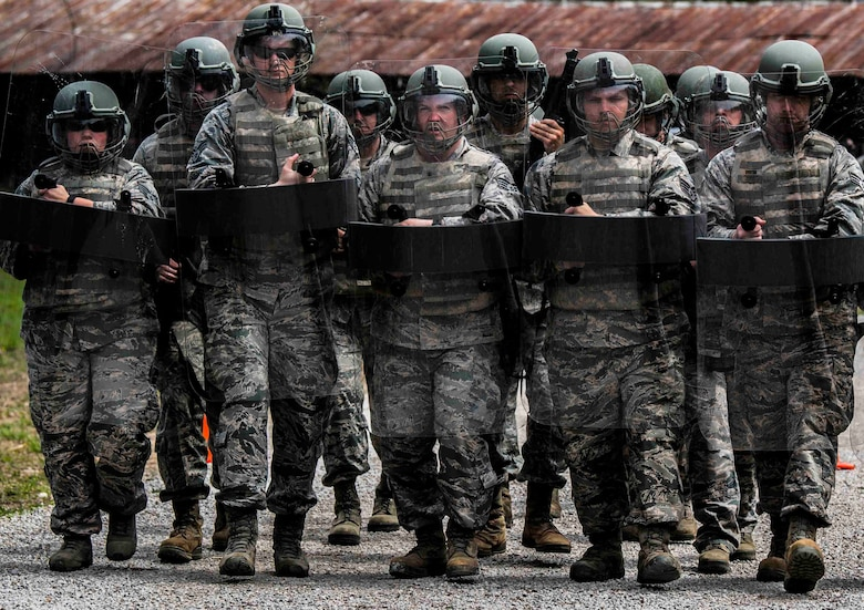 130th Airlift Wing Security Forces Squadron members form a walking shield while participating in riot training April 5, 2017 at Camp Virgil Tate, W.Va. Security forces personnel participated in training that exposed them to numerous scenarios they may encounter during their duties as military police. The training consisted of various non-lethal techniques used to control or quell large crowds.  (U.S. Air National Guard Photo by Tech. Sgt. De-Juan Haley)