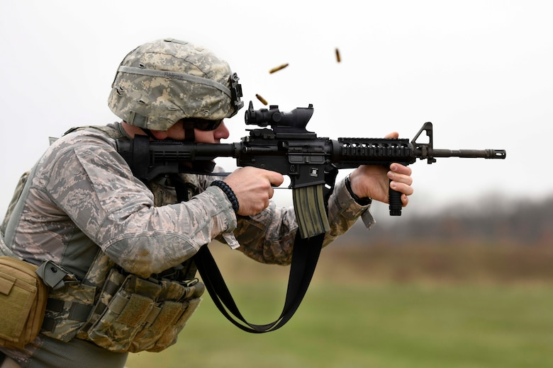 U.S. Air Force Senior Airman Benton Pohlman, a security forces specialist assigned to the 180th Fighter Wing, Ohio Air National Guard, fires an M4 carbine rifle during target practice April 12, 2017 at the Fort Custer Training Center in Battle Creek, Michigan. Weapons training allows Airmen to provide protection of the homeland and effective combat power to their combatant commander. (U.S. Air National Guard photo by Staff Sgt. Shane Hughes)