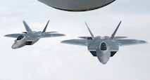 Two U.S. Air Force F-22 fly in formation behind a U.S. Air Force KC-135 Stratotanker from the 340th Expeditionary Air Refueling Squadron during a Combined Joint Task Force- Operation Inherent Resolve mission over Iraq, April 11, 2017. The raptor performs both air-to-air and air-to-ground missions allowing full realization of operational concepts vital to the 21st century Air Force. (U.S. Air Force photo by Senior Airman Joshua A. Hoskins)