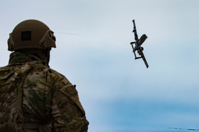 U.S. Air Force Airman 1st Class Diante Cooper, 19th Air Support Operations Squadron Tactical Air Control Party specialist, watches and communicates with an A-10C Thunderbolt II during a joint close air support exercise at Camp Grayling, Mich. April 13, 2017. To further build interoperability and hone their unique skillset, members of the German air force Air Ground Operations Squadron travelled to the U.S. to partner with the 19th ASOS and conduct a close air support exercise working with A-10C Thunderbolts IIs and F-16 Fighting Falcons. (U.S. Air Force photo by Airman 1st Class Daniel Snider)
