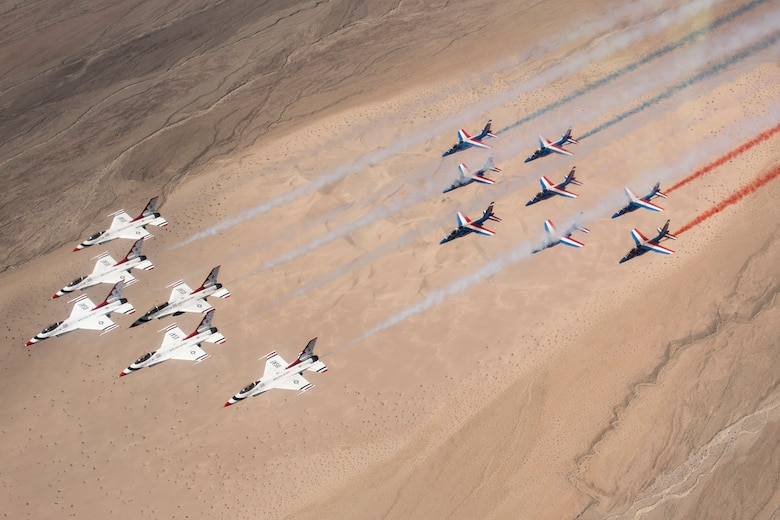 The United States Air Force Thunderbirds and Patrouille de France fly together over Death Valley, Calif., April 17, 2017. The Thunderbirds and Patrouille de France are two of the oldest aerial demonstration teams in the world. (U.S. Air Force Photo by Tech. Sgt. Christopher Boitz)