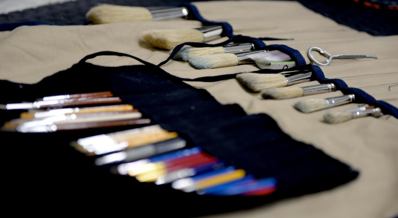 Paint brushes are laid out during a painting project at the Gunter Air Force Base Gym, April 14, 2017. The murals were created by Ian Mangum, a Family Camp reservation specialist with the 42nd Force Support Squadron. His artwork is a collaboration of famous and iconic boxers from past to present. (U.S. Air Force photo/Senior Airman Tammie Ramsouer)