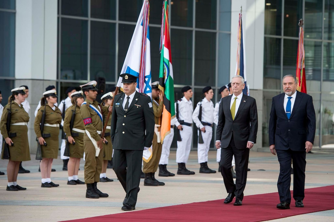 Defense Secretary Jim Mattis walks with Israeli Defense Minister Avigdor Lieberman, who hosted an enhanced honor cordon for Mattis at the Israeli Defense Ministry in Tel Aviv, Israel, April 21, 2017. Mattis is the first cabinet member from the new administration to visit Israel. DoD photo by Air Force Tech. Sgt. Brigitte N. Brantley