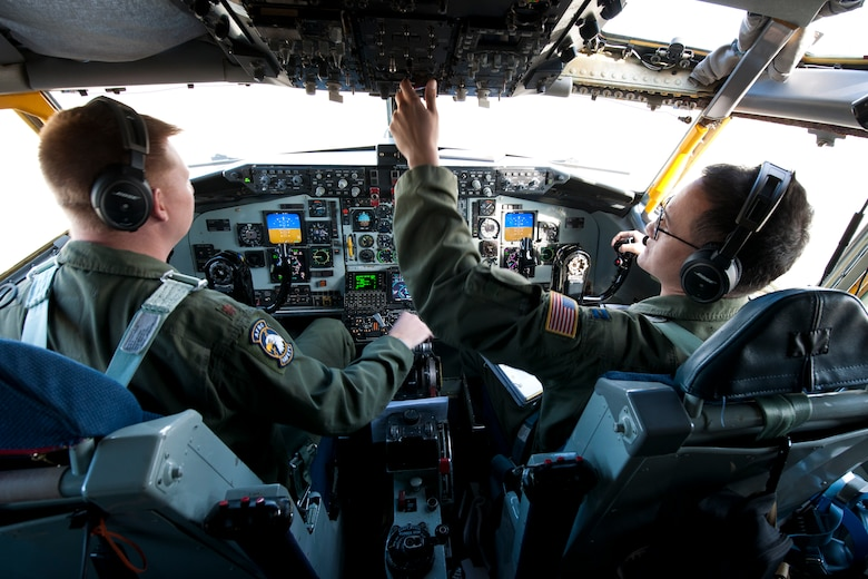 Captain Jason Burrows, 756th Air Refueling Squadron pilot, checks the gauges in KC-135R Stratotanker prior to takeoff from the Joint Base Andrews, Maryland, flight line April 13, 2017. After a year of planning, the 756 ARW embarked on a mission to rendezvous with a Naval Air Systems Command P-8A Poseidon over the Atlantic Ocean for an inflight refueling. The P-8A is the second-ever Navy aircraft to be fitted with a receiver for aerial refueling; the first being the E-6B Mercury nearly 30 years ago. (U.S. Air Force photo/Tech. Sgt. Kat Justen)