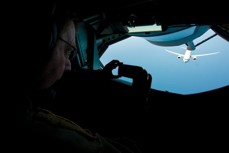 Chief Master Sgt. Frankie Rollins, 756th Refueling Squadron superintendent and boom operator, takes a picture of an incoming Naval Air Systems Command P-8A Poseidon over the Atlantic Ocean April 13, 2017. This was the first successful inflight refueling of the P-8A after a year of planning and coordination with NAVAIR. (U.S. Air Force photo/Tech. Sgt. Kat Justen)