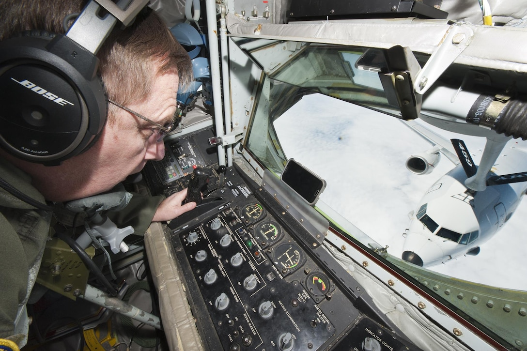 Chief Master Sgt. Frankie Rollins, 756th Refueling Squadron superintendent and boom operator, refuels a Naval Air Systems Command P-8A Poseidon over the Atlantic Ocean April 13, 2017. This was the first successful inflight refueling of the P-8A after a year of planning and coordination with NAVAIR. (U.S. Air Force photo/Tech. Sgt. Kat Justen)