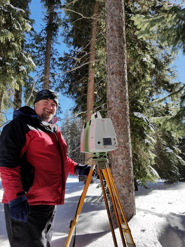 CRREL's Art Gelvin prepares the Leica C10 terrestrial laser scanner for a forest scan. Using high-precision instruments, we hope to understand canopy structure and its relationship to snow, as well as how other sensors observe snow and vegetation.