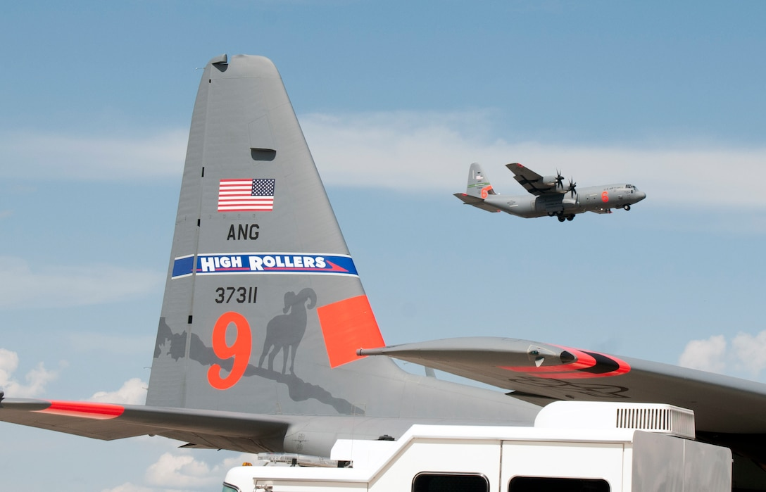 A California Air National Guard C-130 aircraft flies by a Nevada Air National Guard C-130 during this week's Modular Airborne Fire Fighting System training and certification. More than 400 personnel of four C-130 Guard and Reserve units — from California, Colorado, Nevada and Wyoming, making up the Air Expeditionary Group — are in Boise, Idaho for the week-long wildfire training and certification sponsored by the U.S. Forest Service.