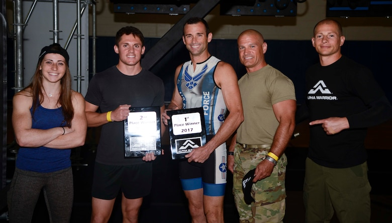 Barclay Stockett, far left, and Brent Steffensen, far right, both Alpha Warrior pros, pause for a photo with the top three winners of the Alpha Warrior Battle Rig competition at MacDill Air Force Base, Fla., April 19, 2017. Participants each received five minutes to successfully complete the obstacle course, and the top three fastest times were selected as winners. (U.S. Air Force photo by Staff Sgt. Vernon L. Fowler Jr.)