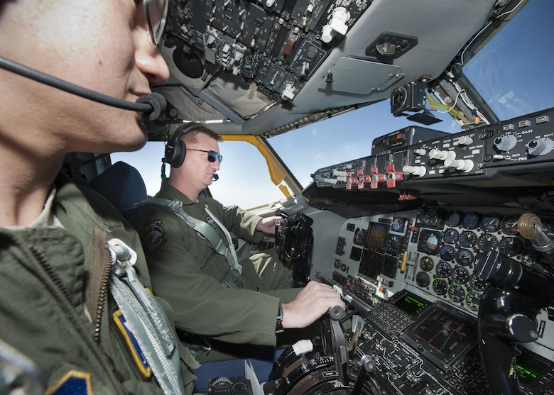 Major Eric Graves, 756th Air Refueling Wing pilot, checks his gauges during a flight over the Atlantic Ocean April 13, 2017. During the flight the 756 ARW conducted the first-ever refueling mission with a Naval Air Systems Command P-8A Poseidon after a year of planning with NAVAIR. (U.S. Air Force photo/Tech. Sgt. Kat Justen)