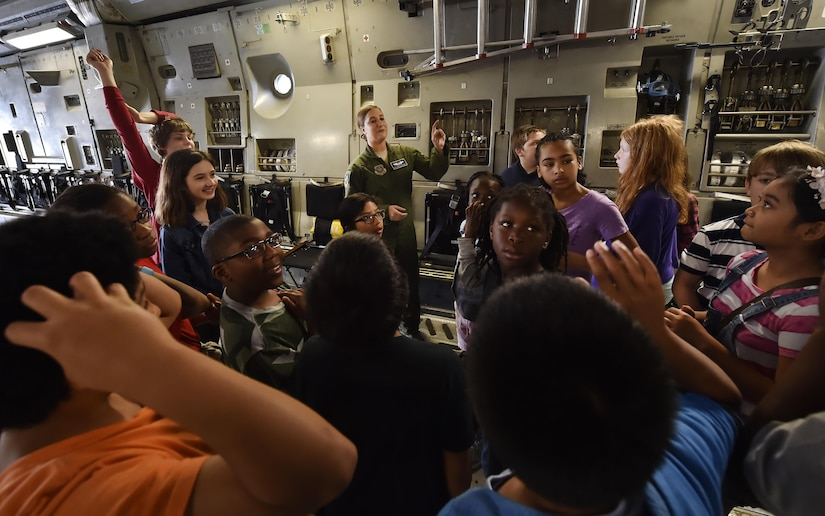 Senior Airman Kayla Zahneis, 14th Airlift Squadron loadmaster, talks to 5th-grade students from Sedgefield Intermediate School during a tour of a C-17 Globemaster as part of a career day event at Joint Base Charleston, S.C., April 20, 2017. The students talked to Airmen and participated in various career field specific demonstrations alongside subject matter experts from various units on the installation. Junior Reserve Officer Training Corps members from Fort Dorchester High School, Orangeburg Wilkinson High School, Summerville High School and Military Magnet Academy were also attended the event.