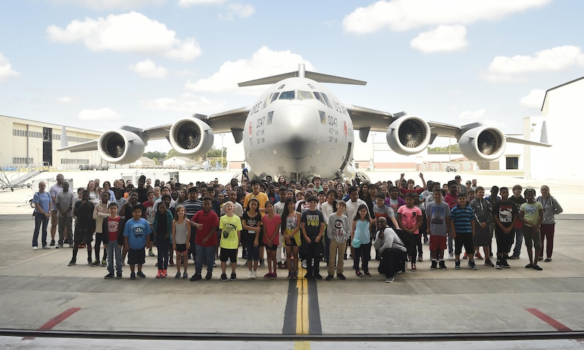 Fifth grade students from Sedgefield Intermediate School stand in front of a C-17 Globemaster after finishing a career day event at Joint Base Charleston, S.C., April 20, 2017. The students talked to Airmen and participated in various career field specific demonstrations alongside subject matter experts from various units on the installation. Junior Reserve Officer Training Corps members from Fort Dorchester High School, Orangeburg Wilkinson High School, Summerville High School and Military Magnet Academy also attended the event.