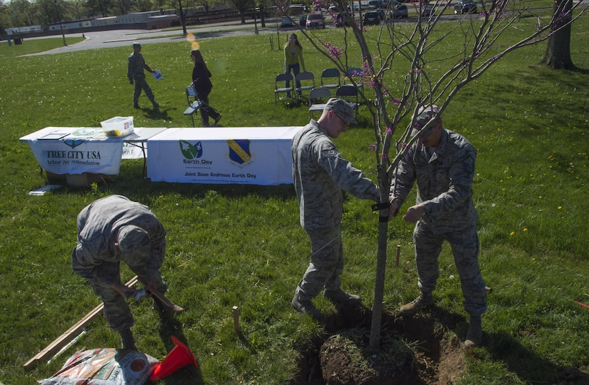 Airmen volunteer at a tree-planting ceremony in celebration of Earth Week and Arbor Day at Joint Base Andrews, Md., April 18, 2017. During the ceremony, Col. E. John Teichert, 11th Wing and JBA commander, received awards from the Maryland Department of Natural Resources for the base's continuing contributions to environmental services. (U.S. Air Force photo by Senior Airman Mariah Haddenham)
