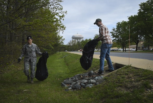 Lt. Col. Sarah Isbill, 811th Security Forces Squadron commander, volunteers to pick up trash during Earth Week on Joint Base Andrews, Md., April 19, 2017. The week also included a tree planting ceremony, seed planting, and a youth art display. (U.S. Air Force photo by Senior Airman Mariah Haddenham)