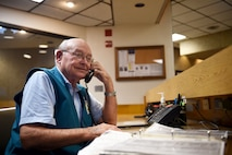 Wilford Hall volunteer Jack Kuttner answers the phone while manning the information desk at the Wilford Hall Ambulatory Surgical Center, Joint Base San Antonio-Lackland, Texas, April 12, 2017. Volunteers can be spotted throughout Wilford Hall assisting patients and staff members. (U.S. Air Force photo/Staff Sgt. Jerilyn Quintanilla)