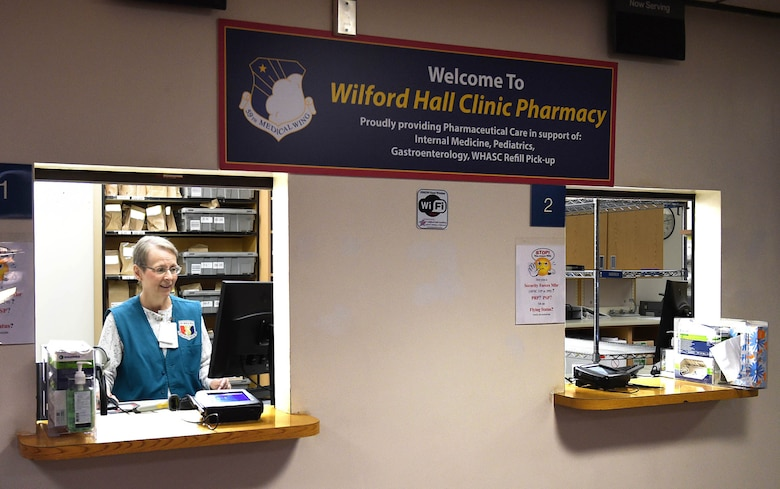 Wilford Hall volunteer Susan Deason helps out in the Wilford Hall Clinic Pharmacy on Joint Base San Antonio-Lackland, Texas, April 12, 2017. Volunteers in the pharmacy help dispense hundreds of medications for beneficiaries and often work at customer service windows. (U.S. Air Force photo/Staff Sgt. Jerilyn Quintanilla) (This photo was altered for security purposes)