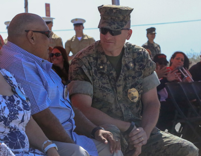 Maj. Daniel Lammers, Provost Marshal, Marine Corps Air Ground Combat Center, Twentynine Palms, Calif., speaks to Salvador Diaz, father of Staff Sgt. Christopher Diaz, during the renaming ceremony of Calcite Road to Diaz Road, April 14, 2017. The road was renamed in honor of Staff Sgt. Diaz, who made the ultimate sacrifice to help a brother in arms while conducting combat operations in Helmand Province, Afghanistan in support of Operation Enduring Freedom. (U.S. Marine Corps photo by Cpl. Medina Ayala-Lo)