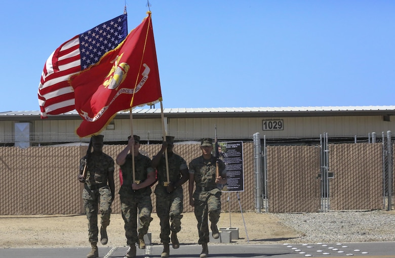 The Combat Center Color Guard prepares to present the National and Marine Corps colors during the renaming ceremony of Calcite Road to Diaz Road, April 14, 2017, aboard the Marine Corps Air Ground Combat Center, Twentynine Palms, Calif. The road was renamed in honor of Staff Sgt. Christopher Diaz who made the ultimate sacrifice to help a brother in arms while conducting combat operations in Helmand Province, Afghanistan in support of Operation Enduring Freedom. (U.S. Marine Corps photo by Cpl. Medina Ayala-Lo)