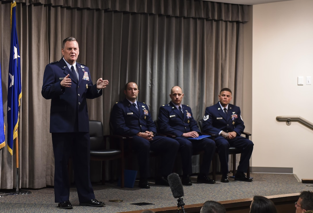 Lt. Gen. Brad Webb, commander of Air Force Special Operations Command, speaks during a Distinguished Flying Cross Ceremony for Maj. Ryan Mittelstet, Maj. Brett Cassidy and Tech. Sgt. Christopher Nin at Hurlburt Field, Fla., April 21, 2017. While assigned to the 8th Expeditionary Special Operations Squadron, Mittelstet, Cassidy and Nin were onboard a CV-22 Osprey conducting a mission to evacuate American citizens during a civil war in Africa. While attempting the evacuation, their aircraft was targeted and hit more than 50 times by surface-to-air fire from ground forces. (U.S. Air Force photo by Airman 1st Class Joseph Pick)
