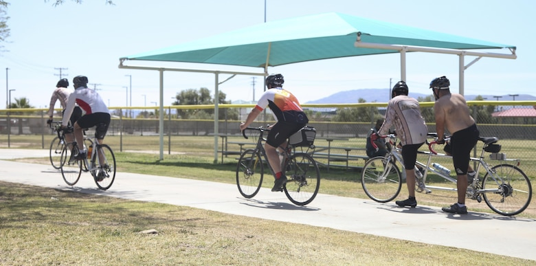 Participants of the annual Earth Day Fun Bike Ride take off from Felix Field aboard Marine Corps Air Ground Combat Center Twentynine Palms, Calif., April 13, 2017. Natural Resources and Environmental Affairs hosts the event annually to raise environmental awareness of Combat Center residents and the local community in the weeks leading up to Earth Day. (U.S. Marine Corps photo by Lance Cpl. Natalia Cuevas)