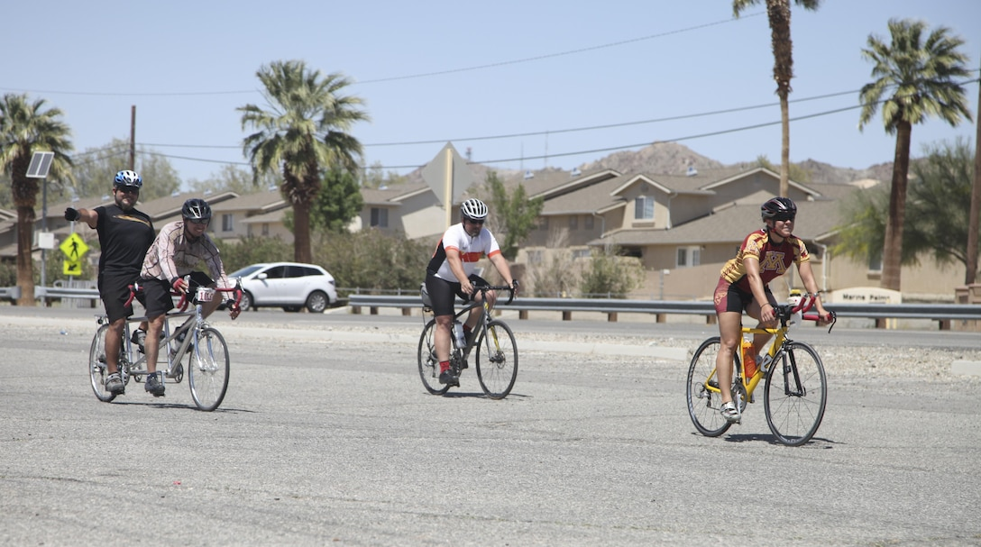 Participants of the annual Earth Day Fun Bike Ride arrive back at Felix Field aboard Marine Corps Air Ground Combat Center, Twentynine Palms, Calif., April 13, 2017. Natural Resources and Environmental Affairs hosts the event annually to raise environmental awareness of Combat Center residents and the local community in the weeks leading up to Earth Day. (U.S. Marine Corps photo by Lance Cpl. Natalia Cuevas)