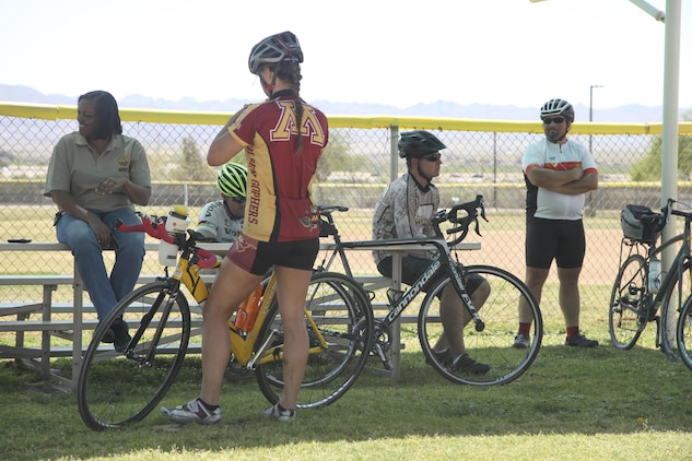 Participants for the annual Earth Day Fun Bike Ride cool off after arriving at Felix Field aboard Marine Corps Air Ground Combat Center, Twentynine Palms, Calif., April 13, 2017. Natural Resources and Environmental Affairs hosts the event annually to raise environmental awareness of Combat Center residents and the local community in the weeks leading up to Earth Day. (U.S. Marine Corps photo by Lance Cpl. Natalia Cuevas)