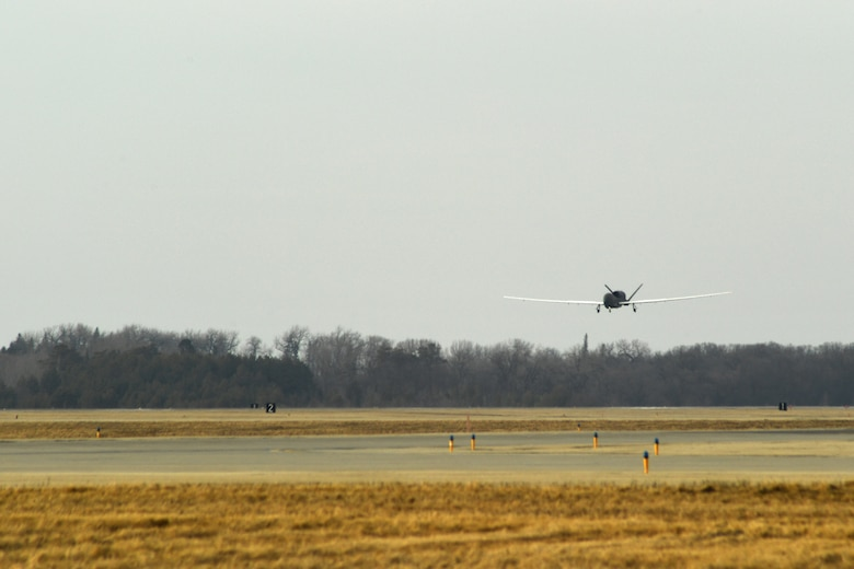 An RQ-4 Global Hawk approaches the runway March 25, 2017, on Grand Forks Air Force Base, N.D. Airmen with the 69th Maintenance Squadron performed the first Air Force-led Mobile Automated Scanner scan on this aircraft, which allowed it to continue its part in supporting the combatant commands. (U.S. Air Force photo by Senior Airman Ryan Sparks)