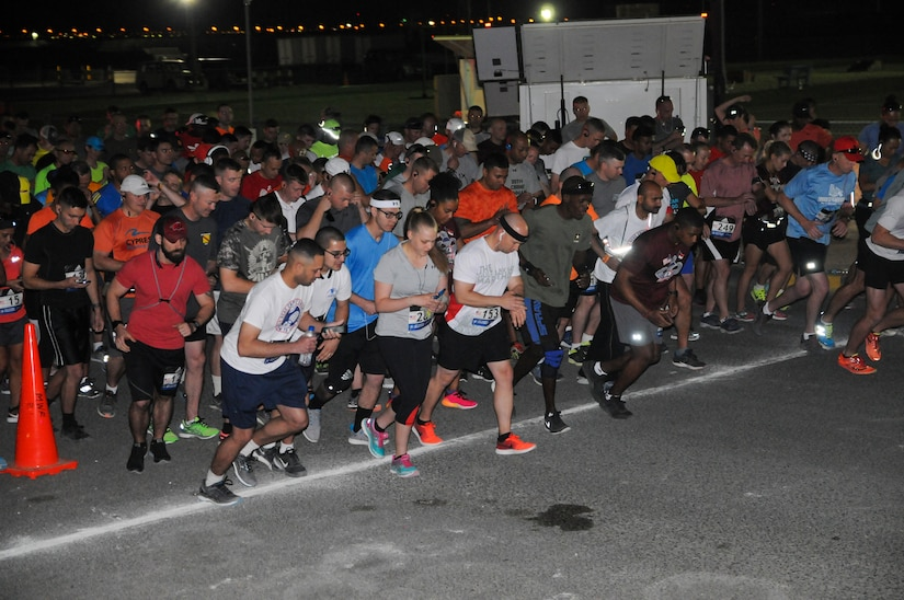 Personnel throughout the U.S. Army Central area of operations step off at 4:02 a.m. for Camp Arifjan's first Boston Marathon Shadow Run, April 17, at Camp Arifjan, Kuwait. This race shadowed the 121st Boston Marathon, but was the first for Camp Arifjan, and gave deployed personnel an opportunity to participate in the famous marathon. More than 300 people participated in the shadow run. (U.S. Army photo by Sgt. Kimberly Browne, USARCENT Public Affairs)