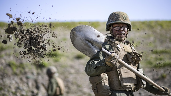 Marine Corps Pfc. Jason Taylor shovels dirt during airfield repair training at Marine Corps Air Station Iwakuni, Japan, April 19, 2017. Taylor is assigned to Marine Wing Support Squadron 171. Marine Corps photo by Lance Cpl. Joseph Abrego