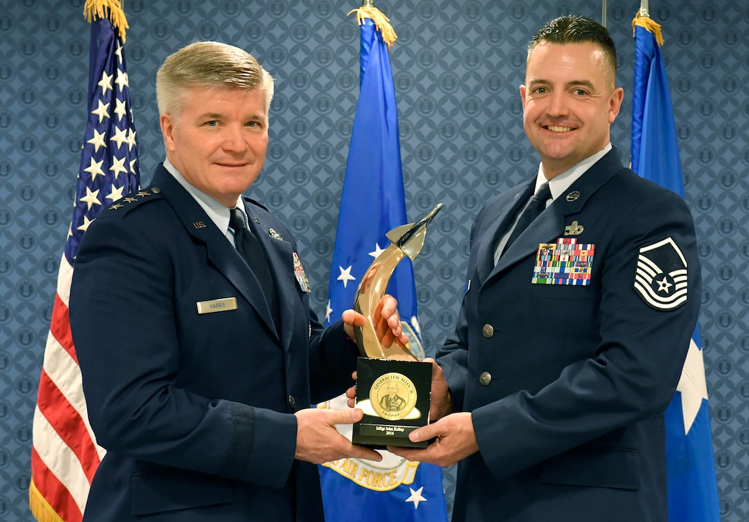 Lt. Gen. Jerry Harris, the deputy chief of staff for strategic plans, programs and requirements, presents Master Sgt. John Kelly the Gen. Lew Allen Jr. Trophy for 2016, during a ceremony at the Pentagon, April 21, 2017. (U.S. Air Force photo/Wayne A. Clark)