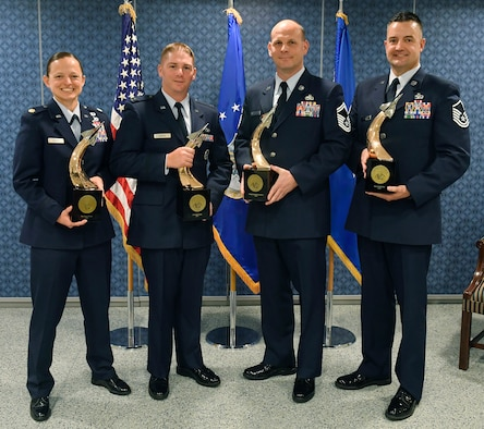 (From left) Maj. Jessica Stewart, Capt. Joseph Spada, Senior Master Sgt. Randolph Crosslin Jr. and Master Sgt. John Kelly each received their Gen. Lew Allen Jr. Trophy for 2016, during a ceremony at the Pentagon, April 21, 2017.  (U.S. Air Force photo/Wayne A. Clark)