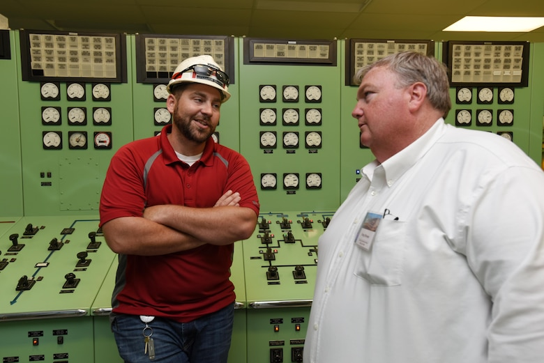 John Bell (Left), power plant trainee, speaks Greg Brown, plant manager with the Georgia Power Company, during a tour of the Old Hickory Dam powerhouse control room in Old Hickory, Tenn., April 19, 2017. Brown visited the facility while attending the 40th Annual Joint Hydropower Conference in Nashville Tenn.