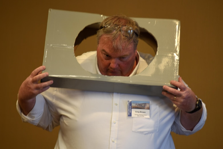 Greg Brown, plant manager with the Georgia Power Company, demonstrates the size of the entry hold into confined spaces at Lloyd Shoals Dam Powerhouse in Jackson, Ga. He provided a technical briefing on a project his team accomplished to add access tunnels into the turbines during the 40th Annual Joint Hydropower Conference April 19, 2017 in Nashville Tenn.