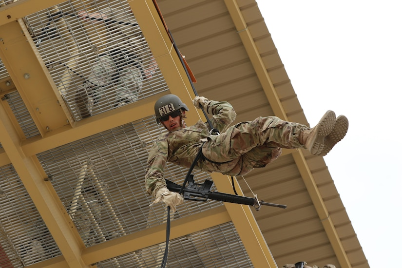 U.S. Army Spc. Dylan Gustaitis, radiology specialist, 215th Brigade Support Battalion, 3rd Armored Brigade Combat Team, 1st Cavalry Division, rappels off a tower at Kuwait's first Air Assault Course, April 12, 2017, at Camp Buehring, Kuwait. Rappelling off a 50-foot tower is one of several tests students have to pass within in the three phases of the course. The Air Assault Course is a 12-day class that allows U.S. military personnel in the U.S. Army Central area of operations the unique opportunity to become air assault qualified, while deployed outside the continental United States.