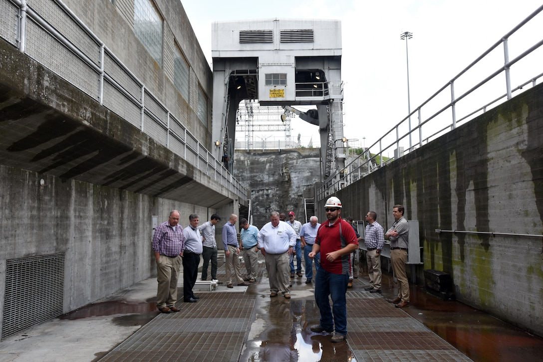 John Bell, power plant trainee, leads a group of hydropower experts attending the 40th Annual Joint Hydropower Conference in Nashville Tenn., on a tour of Old Hickory Dam in Old Hickory, Tenn., April 19, 2017.