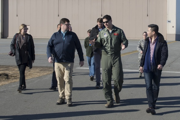 """U.S. Air Force Capt. Jack Johnston, an 18th Aggressor Squadron F-16 Fighting Falcon aircraft pilot, speaks with Congressional staff delegates 18 April, 2017, at Eielson Air Force Base, Alaska. One stop during the base tour involved a static display of the F-16, which recently received the new """"Splinter"""" pattern."""