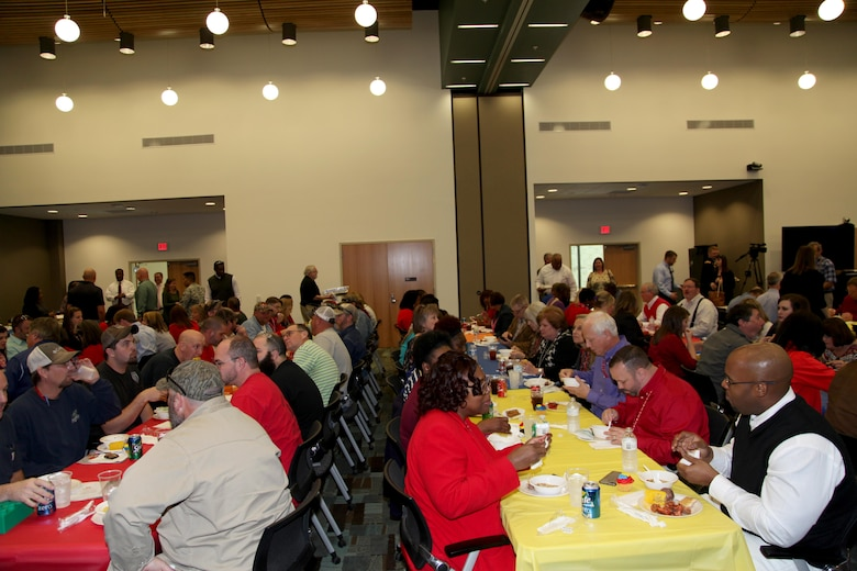 Attendees of the Executive Office/Directorate of Enterprise Operations Town Hall enjoy a crawfish and jambalaya lunch after the event.
